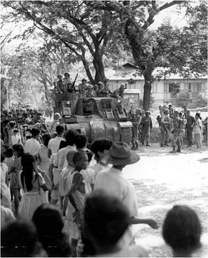Battle for Cebu City - US troops riding on an M7 Priest enter Cebu City