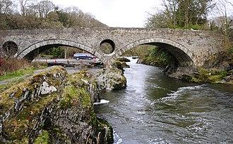 Cenarth Bridge - The bridge viewed from downstream north bank (Carmarthenshire right, Ceredigion left)