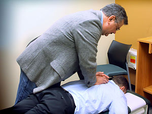 Spinal adjustment - A chiropractor performs an adjustment on a patient.