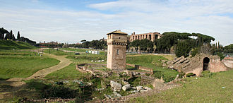 Circus Maximus - View of the Circus site from the south-east. The tower in the foreground is part of a medieval fortification.