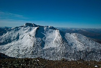 Càrn Mòr Dearg - Carn Mor Dearg as seen from Aonach Mor showing the snow bowl that attract off piste snowsports enthusiasts. Taken late winter with a poor snow cover. Ben Nevis is behind