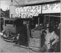 Coolidge, Arizona. On main street of western cotton town Saturday afternoon during cotton harvest. - NARA - 522266.tif