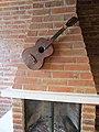 Cuicocha, Ecuador Reserva ecológica Cotacachi-Cayapasm .interior, guitar on a brick wall. six string.jpg