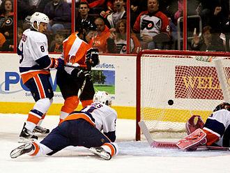 Daniel Brière - Daniel Brière (centre) watches a goal go in against the New York Islanders.