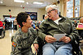 Defense.gov News Photo 101215-F-0681L-2552 - U.S. Army Staff Sgt. Amy Wieser Willson left with the 231st Brigade Support Battalion North Dakota National Guard visits with a resident of the.jpg