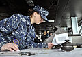 Defense.gov News Photo 110127-N-6003P-027 - Petty Officer 3rd Class Sarah Nelson uses a parallel motion protractor to plot the position of the aircraft carrier USS Harry S. Truman CVN 75 as.jpg