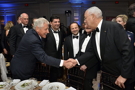 Defense Secretary Chuck Hagel, left, is greeted by former Secretary of State Colin Powell before the start of the 2014 Atlantic Council's awards ceremony and dinner in Washington, D.C., April 30, 2014 140430-D-NI589-061a