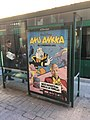 Donald Duck ad on tram shelter (41963678604).jpg