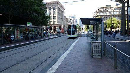 Spencer Street tram stop in February 2014 E 6005 tram arriving at the Southern Cross tram stop on the St Kilda to East Brunswick route 96.jpg