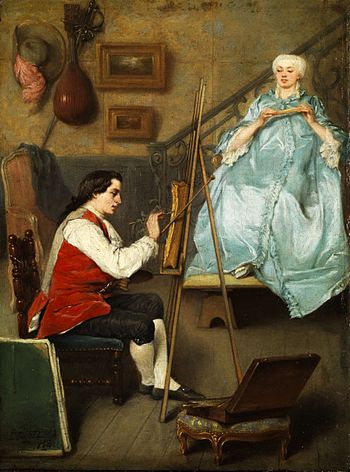 Young painter portraiting a young women in a b...