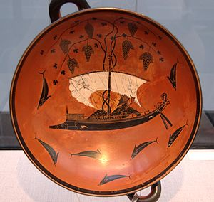 Dionysus - The Dionysus Cup, a 6th-century BC kylix with Dionysus sailing with the pirates he transformed to dolphins