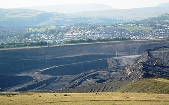 Merthyr Tydfil County Borough - Part of Ffos Y Fran open cast mine, overlooking Dowlais, Penydarren and Gurnos, with the Breacon Beacons in the distance.