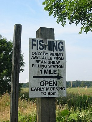 Fishing license - Sign in the United Kingdom alerts people to the need for a fishing permit.