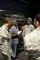 Fleming Outerbridge, an Engagement Skills Trainer (EST), shows EST rifle components to a group of United States Army and United States Air Force service members as he gives them an EST operator class at Chievres 130425-A-BD610-013.jpg