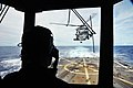 Flickr - Official U.S. Navy Imagery - A Navy officer acts as a helicopter control officer..jpg