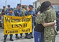 Flickr - Official U.S. Navy Imagery - A Sailor hugs his wife pier side in Guam..jpg