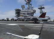 Flickr - Official U.S. Navy Imagery - A jet lands aboard USS Nimitz as two CO completes his 1,000th carrier landing.