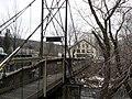 Footbridge crossing Lamoille River Main Street Hardwick VT March 2013.jpg