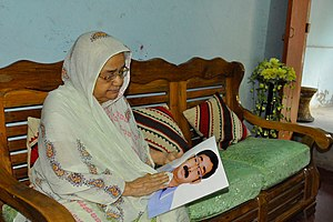 Forced disappearance in Bangladesh - A mother with a photo of her son who became a victim of forced disappearance in 2013 (image by VOA)