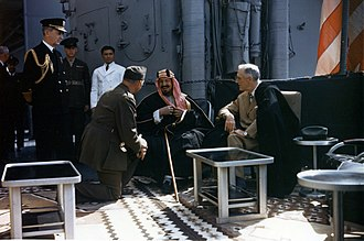Ibn Saud - King Ibn Saud converses with President Franklin D. Roosevelt (right) through interpreter Colonel Bill Eddy, on board the USS ''Quincy'', after the Yalta Conference. Fleet Admiral William D. Leahy (left) watches.