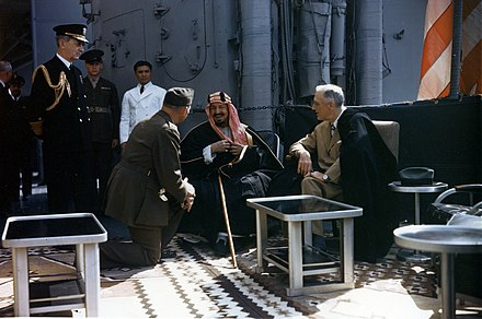 President Roosevelt with Abdul Aziz of Saudi Arabia and William Leahy aboard Quincy Franklin D. Roosevelt with King Ibn Saud aboard USS Quincy (CA-71), 14 February 1945 (USA-C-545).jpg