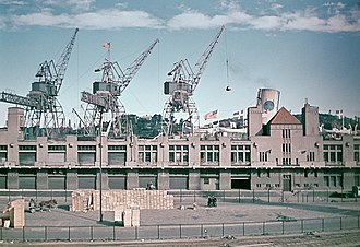 """Swedish American Line - Stigbergskajen quay in Gothenburg where the steamers of the Swedish American Line moored, and the port terminal """"The American Shed"""". Shown in 1944."""