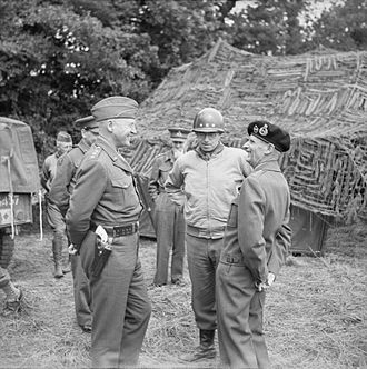 Omar Bradley - Bradley (center) with Patton (left) and Montgomery (right) at 21st Army Group HQ, Normandy, 7 July 1944.
