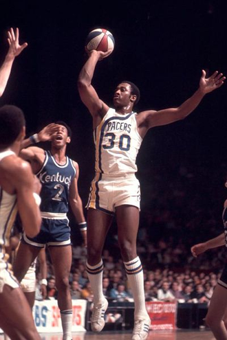 George McGinnis - McGinnis with the Indiana Pacers during a game in the 1972-73 season versus the Kentucky Colonels