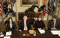 George and Laura Bush attend a briefing on volunteerism.jpg