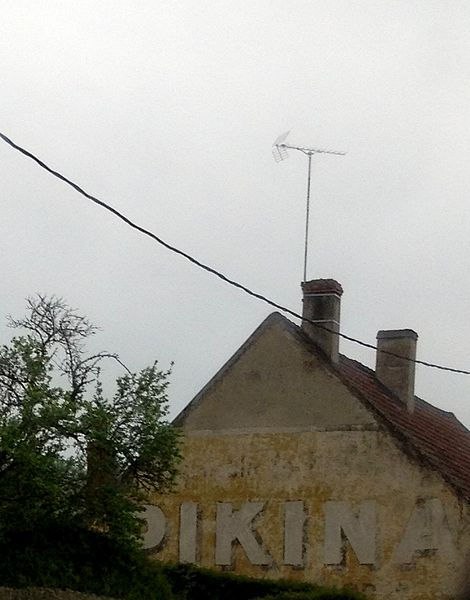 """Ghost sign """"Pikina"""" in Armes (Nièvre)."""