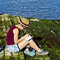 Girl taking notes at the river border (19443620213).jpg