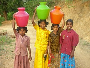Water supply and sanitation in India - Four girls carrying water in India