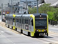Gold Popoff train on East 1st Street, July 2017.JPG