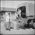 Granada Relocation Center, Amache, Colorado. Personal belongings being loaded in trucks and hauled . . . - NARA - 539939.tif