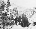 Group of men in snow-covered camp at the foot of White Pass (CURTIS 546).jpeg