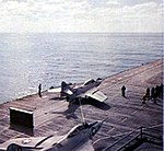 Grumman F9F-8 Cougars of VA-44 on USS Wasp (CVS-18), circa in September 1957.jpg