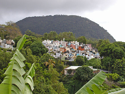 A church cemetery perched in the mountains of Guadeloupe Guadeloupe (Le cimetiere de Gourbeyre).jpg
