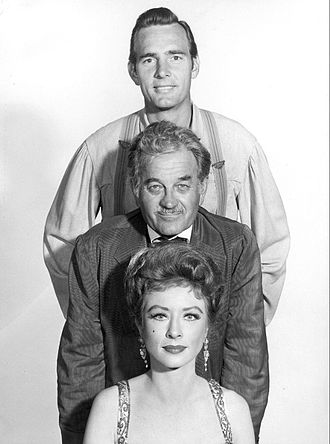 Dennis Weaver - Weaver as Chester, Milburn Stone as Doc, and Amanda Blake as Kitty in Gunsmoke, 1960