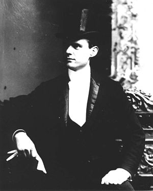 Hamilton Love - Love, wearing top hat and tails c. 1898.