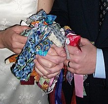 An example of a handfasting knot where each wedding guest has tied a