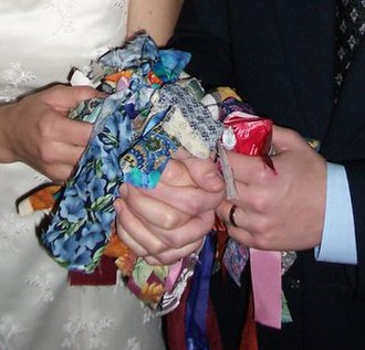 Handfasting (Neopaganism) - An example of a handfasting knot where each wedding guest has tied a ribbon around the clasped hands of the couple.