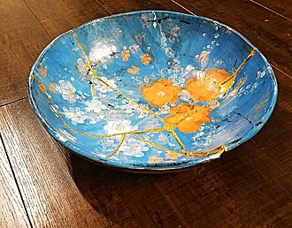 Kintsugi - Hand built and hand-painted ceramic bowl broken during the firing process was repaired by Kintsugi. Created by Ruthann Hurwitz, The Village Potter