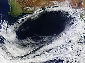 Anticyclone - True color satellite image of an unusual anticyclone off southern Australia in the Southern Hemisphere, on September 8, 2012, showing a counter-clockwise rotation around an oval area of clear skies.