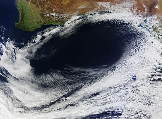 True color satellite image of an unusual anticyclone off southern Australia in the Southern Hemisphere, on September 8, 2012, showing a counter-clockwise rotation around an oval area of clear skies. High pressure Area Sep 08 2012.jpg