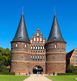 Holstentor in Lübeck, Germany. View from Holstenplatz. Next to the gate (right) the historical Salzspeicher.