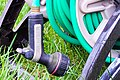 Hose reel with hanging water nozzle.jpg