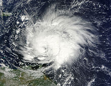 A satellite image of a well-developed tropical cyclone entering the Caribbean Sea.