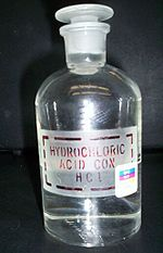 "Transaprent chemical bottle with a glass cap and lable ""hydrochloric acid. Con. HCl"""