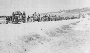 Charge at Haritan - No. 12 Light Armoured Motor Battery and No. 7 Light Car Patrol with the 5th Cavalry Brigade on the road north of Aleppo. Mehemet Ali military barracks in background