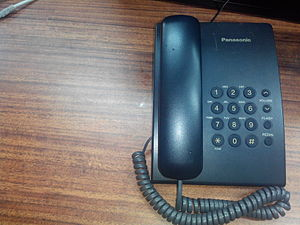 Landline - A fixed-line telephone on a desk